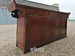 A Impressive Large Chinese Sideboard with Dragon Carvings and Fretwork