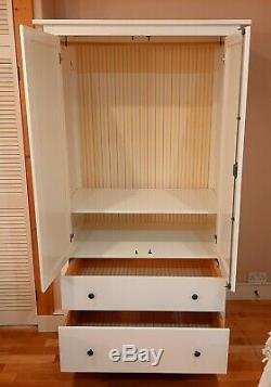 Large 2 door wardrobe with deep drawers. Sturdy. Cannot be disassembled