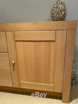 Large contemporary solid light oak sideboard with 2 door cupboards, 3 drawers