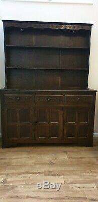 Large solid dark oak carved 3 door/drawers dresser
