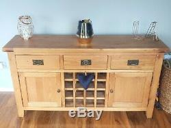 Large solid oak sideboard with built in wine storage, 2 doors, and 3 drawers