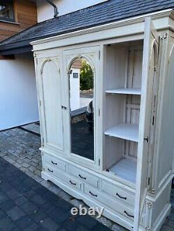 Large triple door wardrobe and drawers in off white in three sections