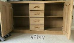 Used large solid wooden sideboard with 4 drawers and 2 doors from Glasswells